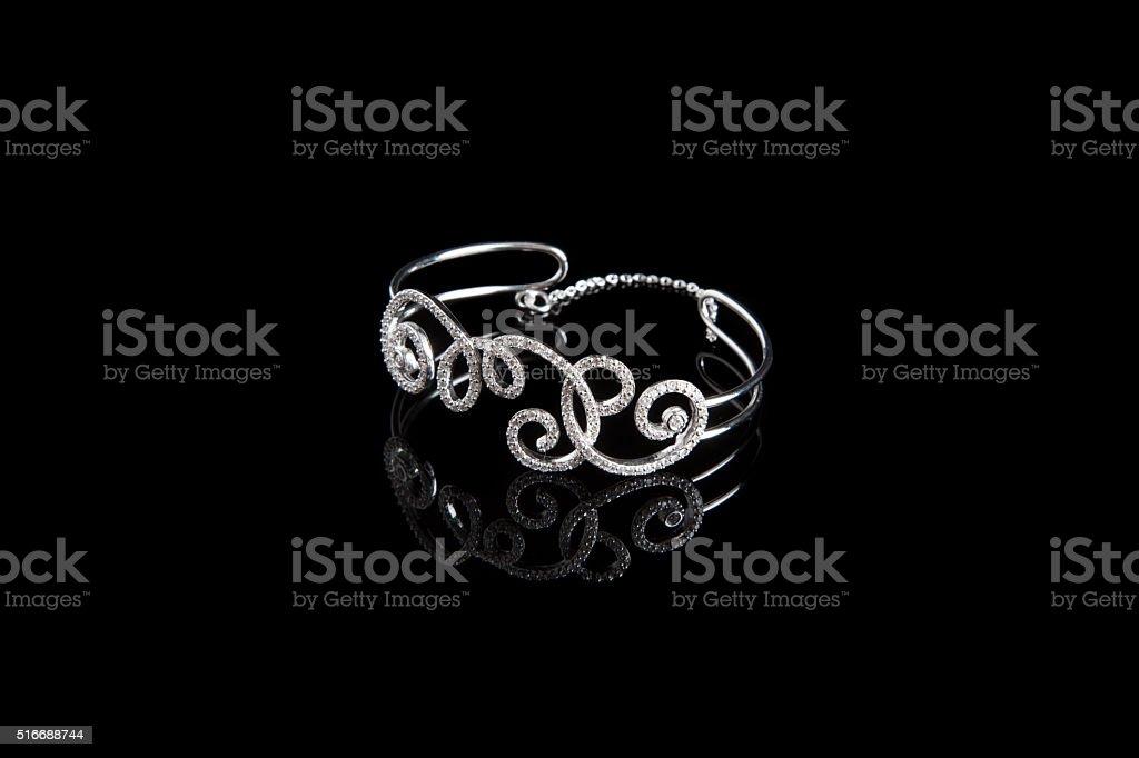 Luxury Bracelet with Diamond Gemstones on Black Background stock photo