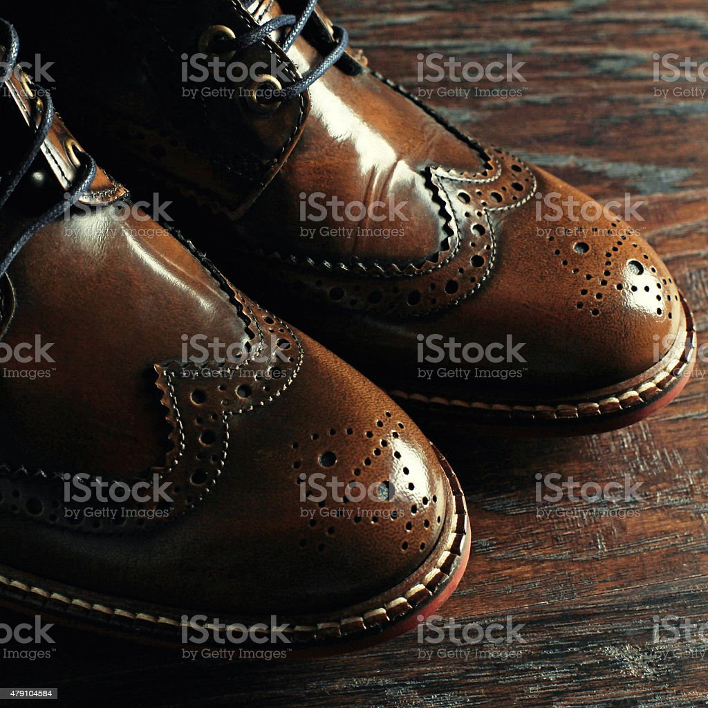luxury brown shoes on wood background stock photo