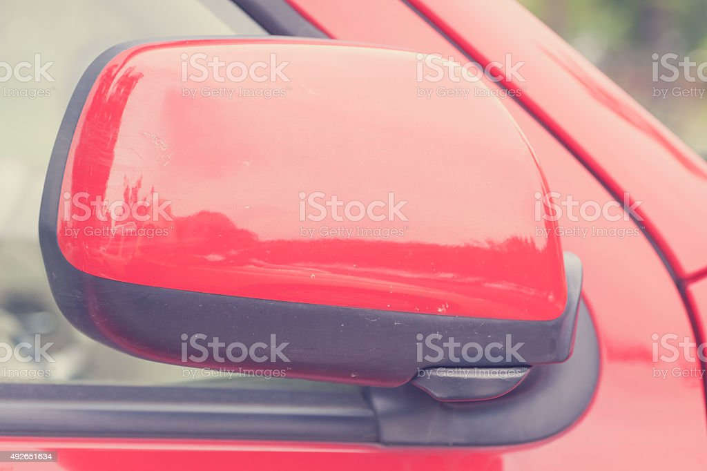 luxury car closed wing mirror after parking for safty drive stock photo