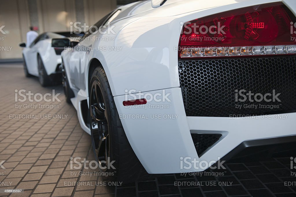 luxury cars in front of dubai mall stock photo