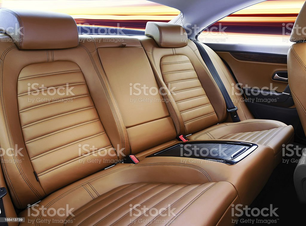 Luxury car's passenger seat interior in tan leather stock photo