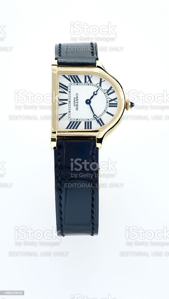 luxury Cartier Cloche gold wristwatch stock photo