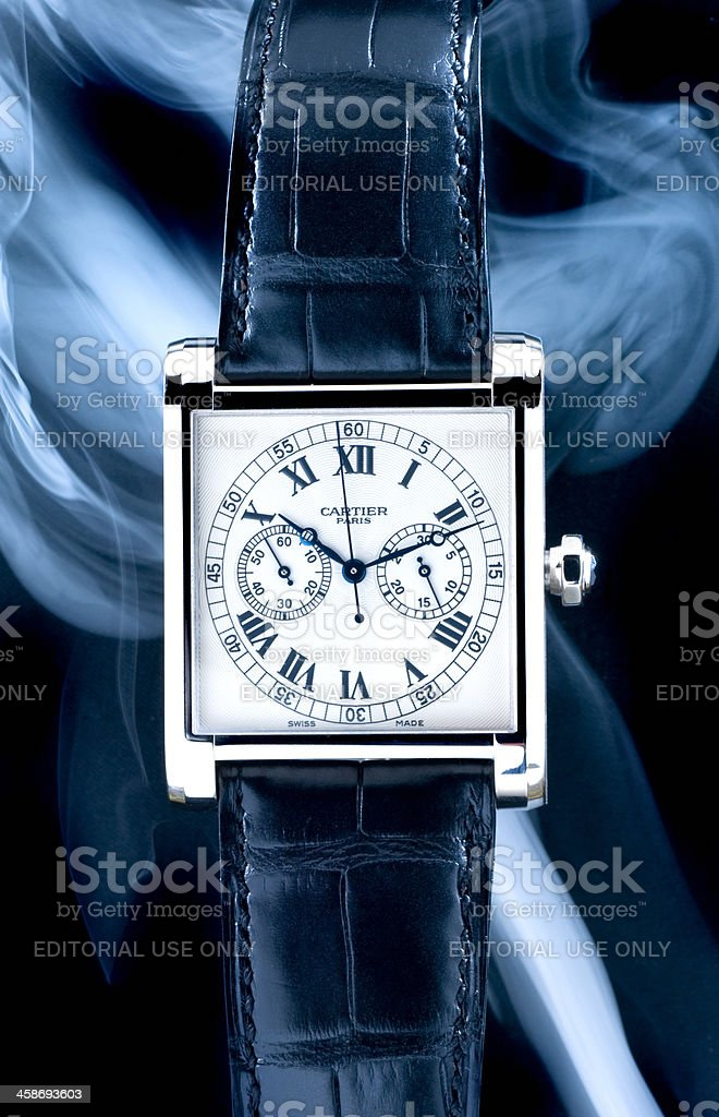 luxury Cartier Tank Mono Poussoir wristwatch stock photo
