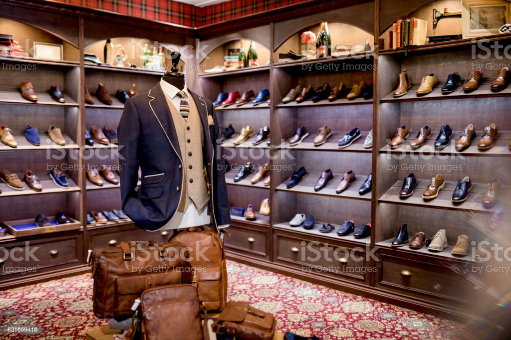 Interior of a high-quality shop for men with shoes on display. A cosy...