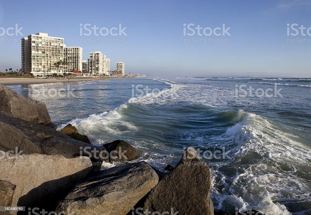 Luxury Condos Rocks Waves stock photo