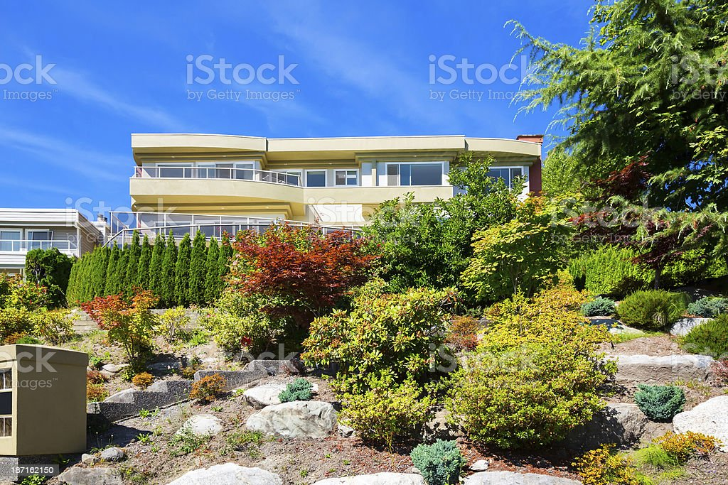 Luxury contemporary home sits on a hilltop royalty-free stock photo