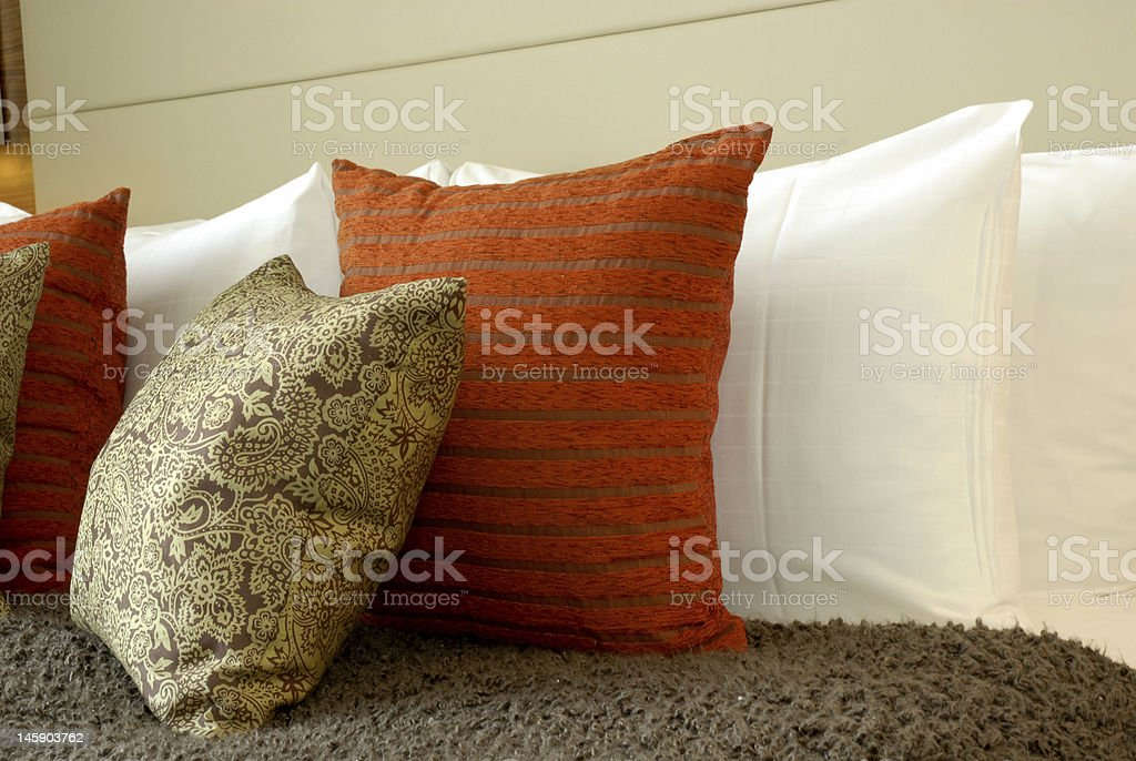 Luxury cushions against white pillows. royalty-free stock photo