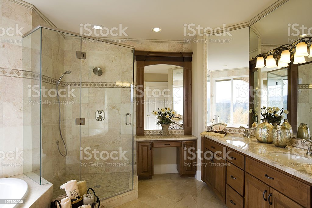 Luxury custom designed showcase estate bathroom wood cabinets marble stock photo