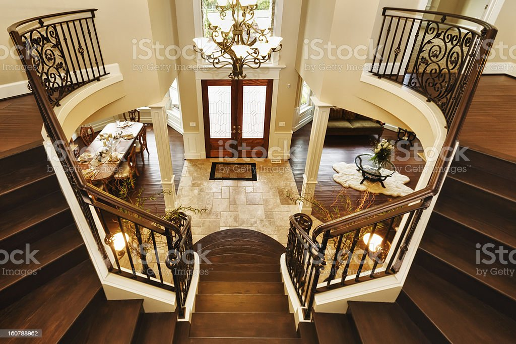 Luxury custom home entrance interior grand staircase royalty-free stock photo