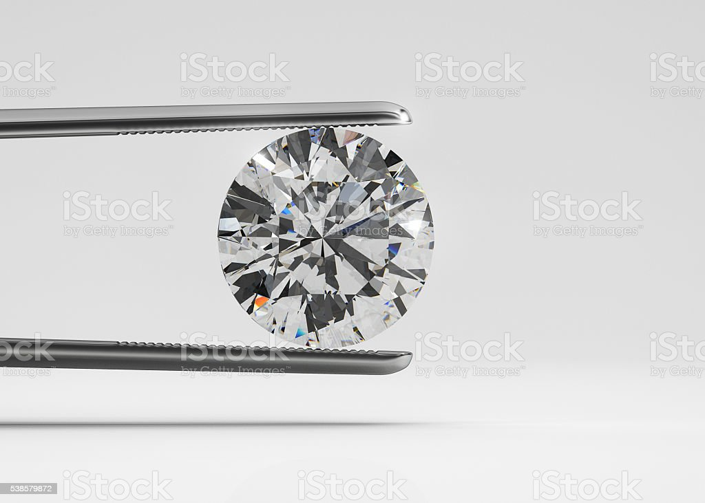 Luxury diamond in tweezers stock photo