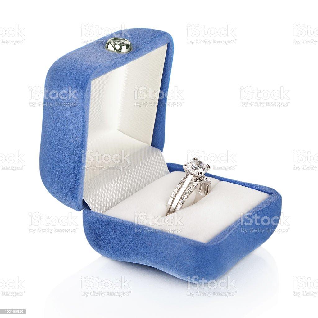 Luxury Diamond Wedding Ring in Blue Velvet Silk Box royalty-free stock photo