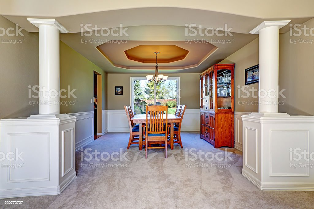 Luxury dining room with white columns stock photo