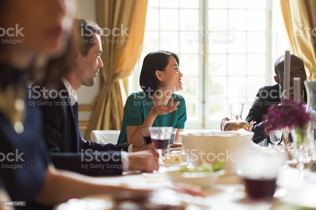 Luxury dinner, friends eating together stock photo