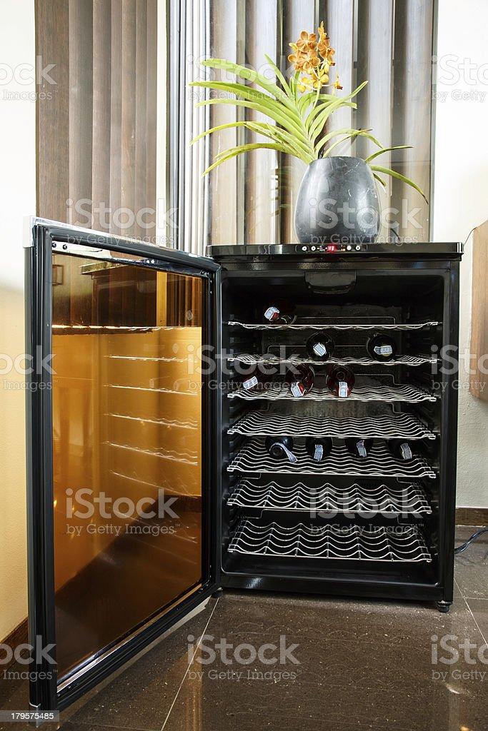 Luxury electronic wine cooler with door open stock photo