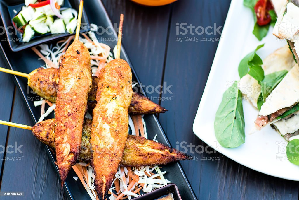 Luxury feed fat from the chicken on a skewer stock photo