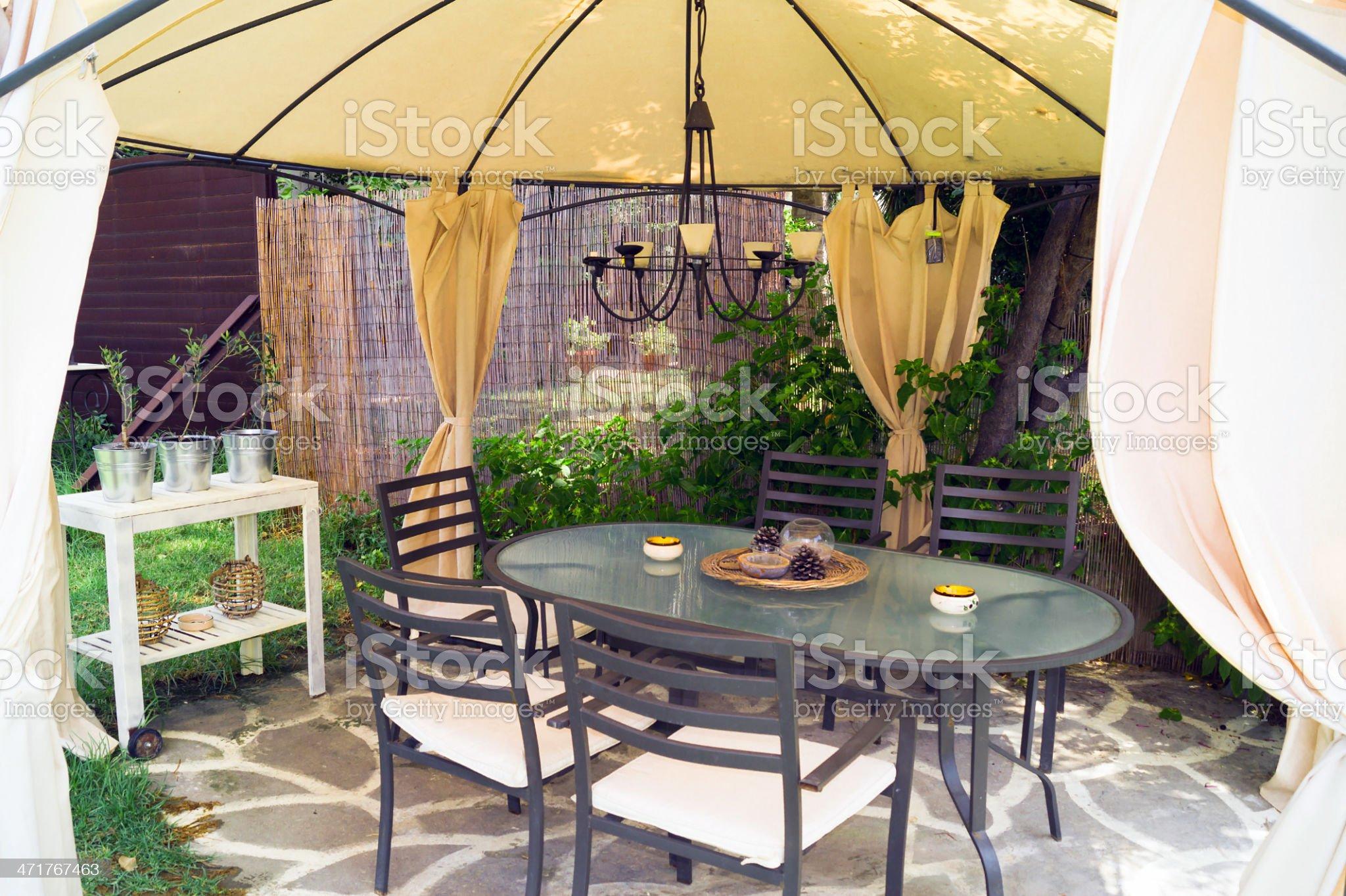 Luxury garden furniture at green yard royalty-free stock photo