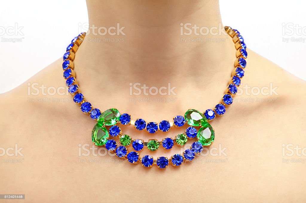 luxury gemstone necklace on a woman's neck stock photo