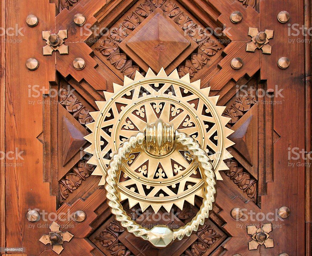 Luxury Golden doorknocker stock photo