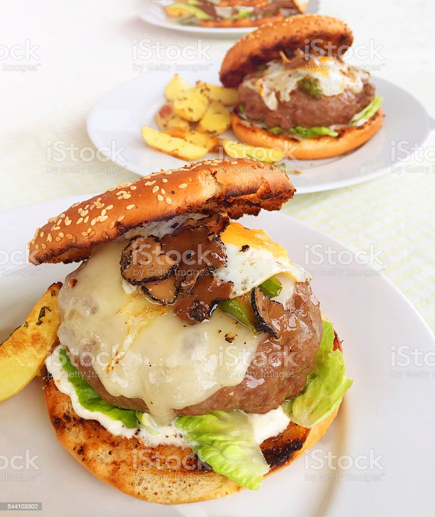 Luxury Gourmet Burger with Truffles and Quail Egg stock photo