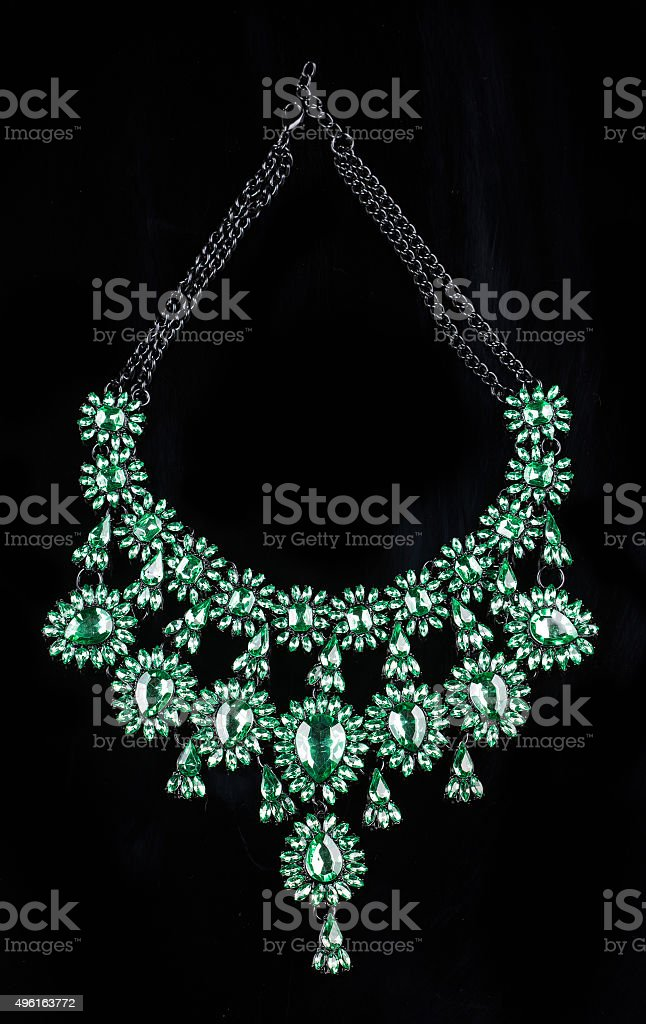 luxury green necklace on black stand stock photo