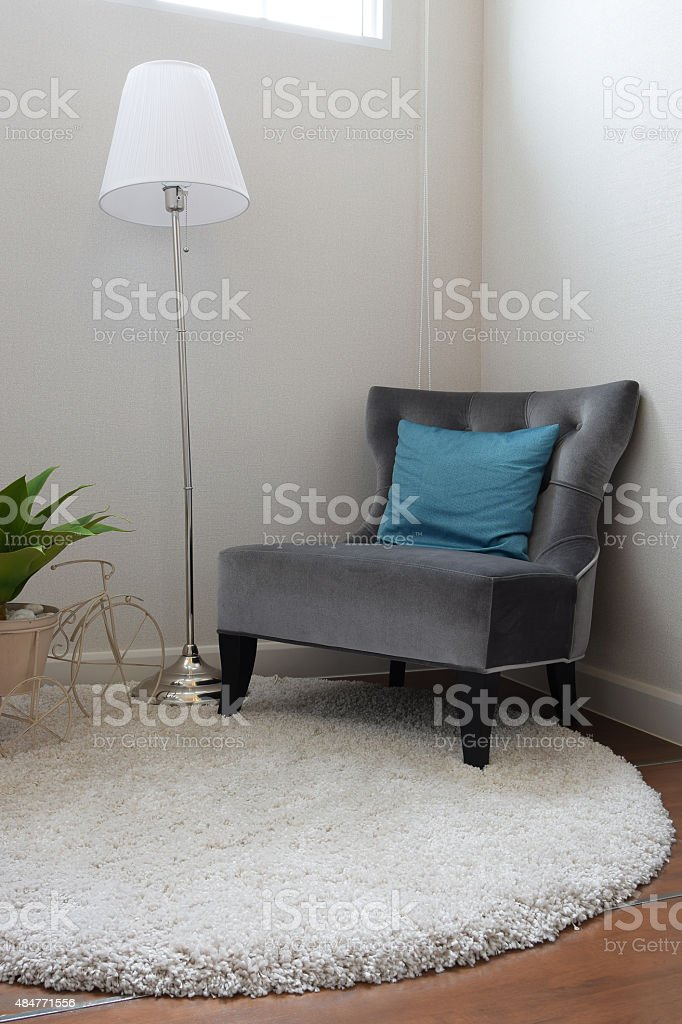 luxury grey tweed sofa with blue pillow in living room stock photo