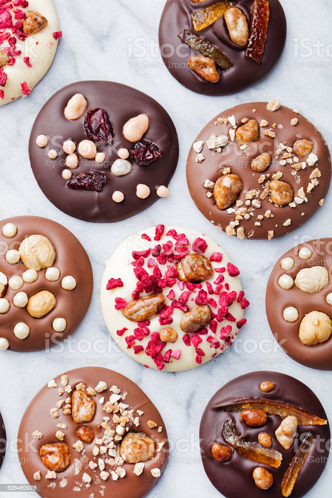 Luxury handmade chocolate mediants, cookies, bites, candies. French Christmas dessert stock photo