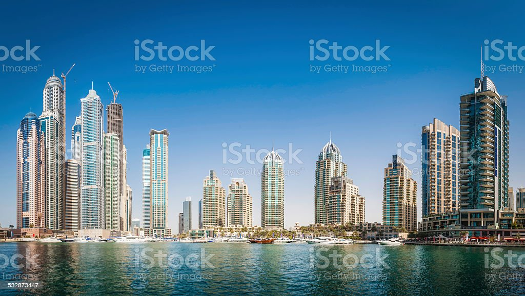 Luxury highrise apartments soaring into blue sky above Dubai Marina stock photo