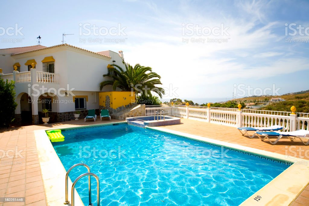Luxury holiday vacation villa with private swimming pool royalty-free stock photo