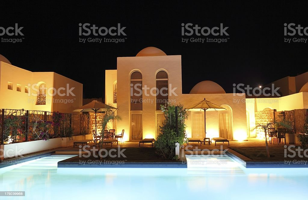 Luxury holiday villa with swimming pool in the evening. royalty-free stock photo