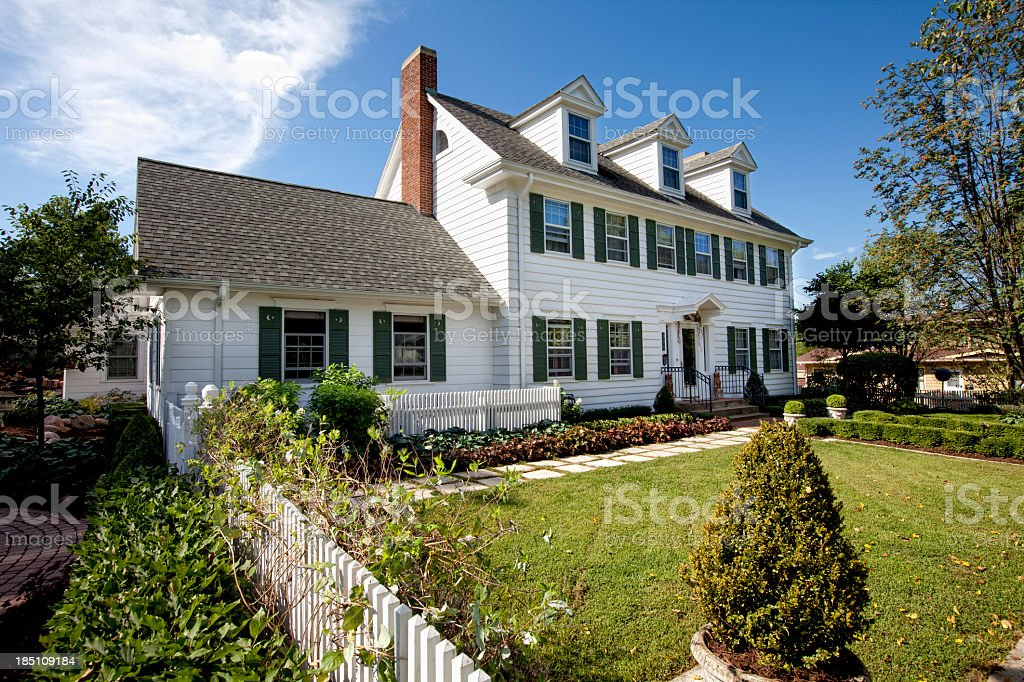 Luxury home in white with green grass stock photo