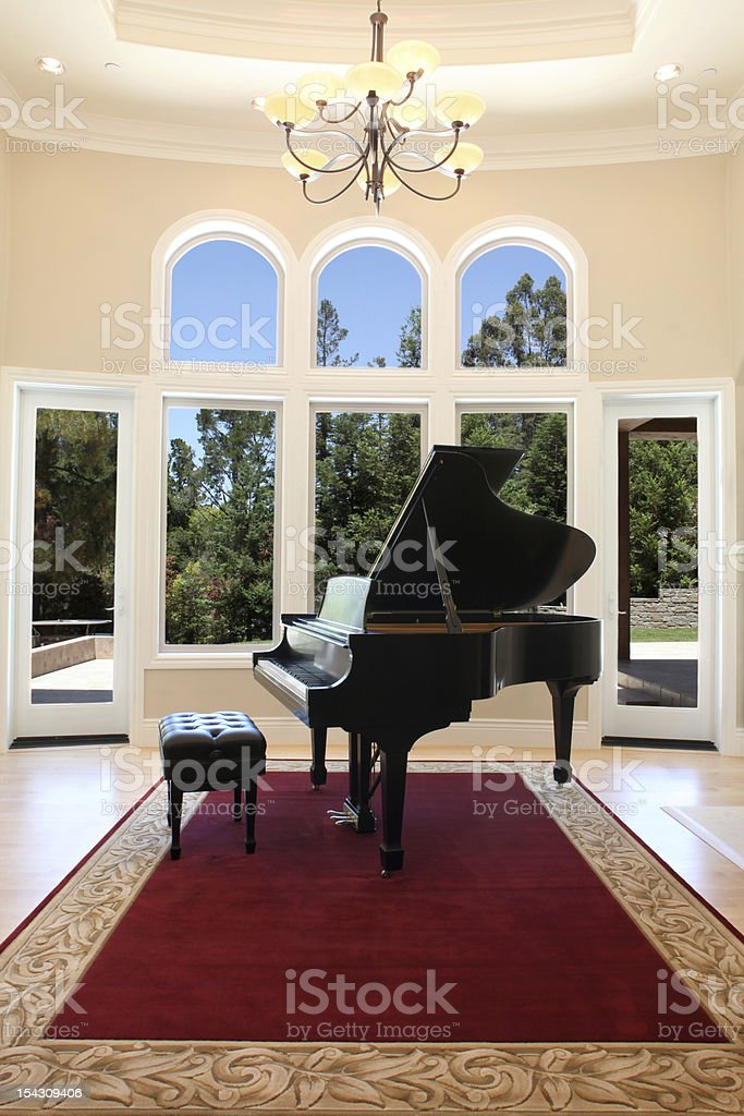 Luxury Home with Grand Piano stock photo