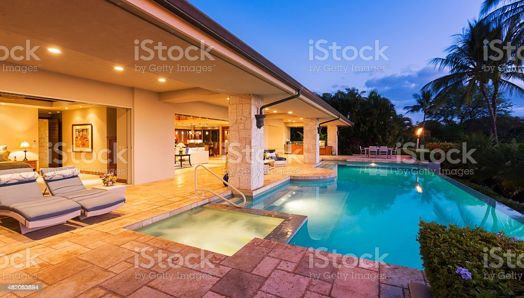 Luxury Home with Pool at Sunset stock photo