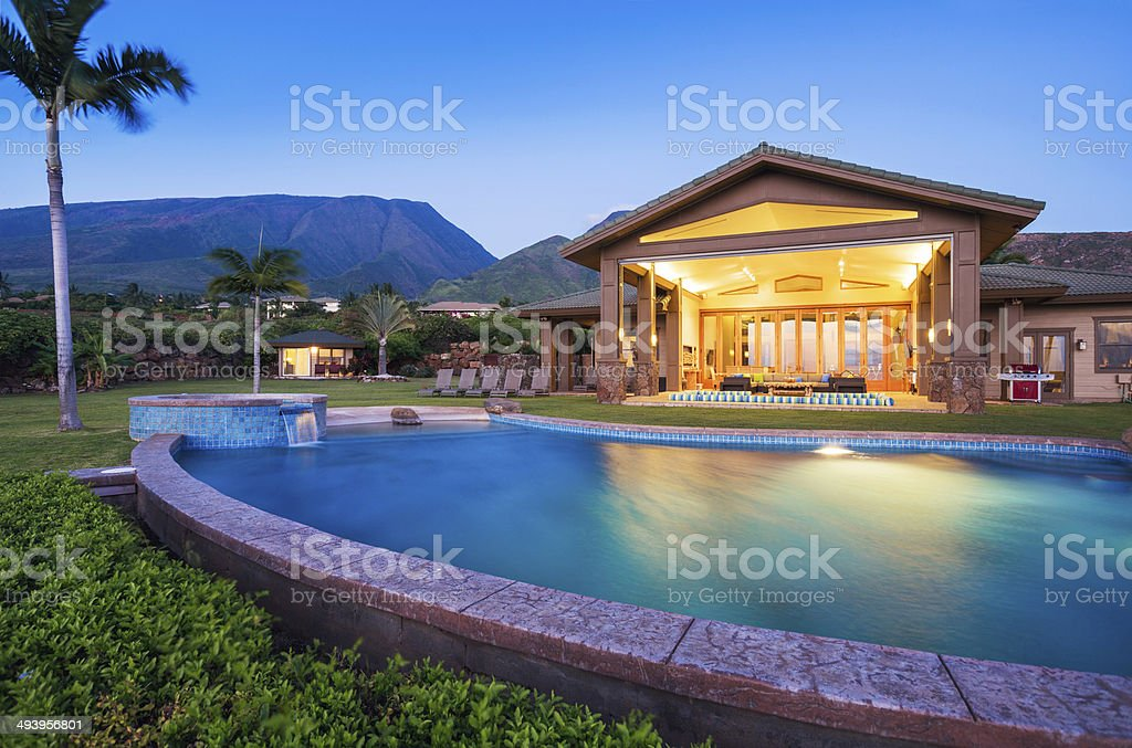 Luxury home with swimming pool stock photo