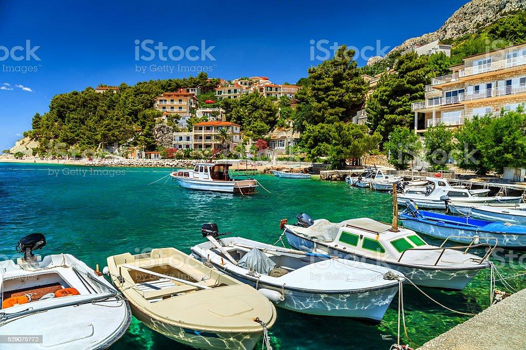 Luxury homes and fishing boats in harbor,Brela,Dalmatia,Croatia stock photo