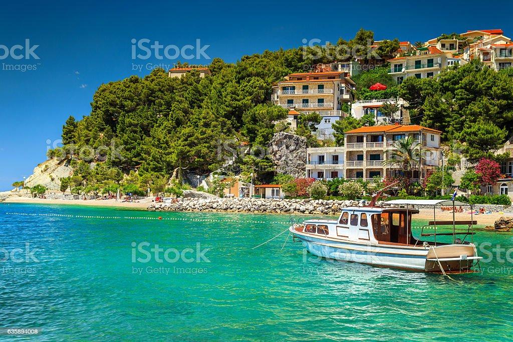 Luxury homes with tourist boat in harbor, Brela, Dalmatia, Croatia stock photo