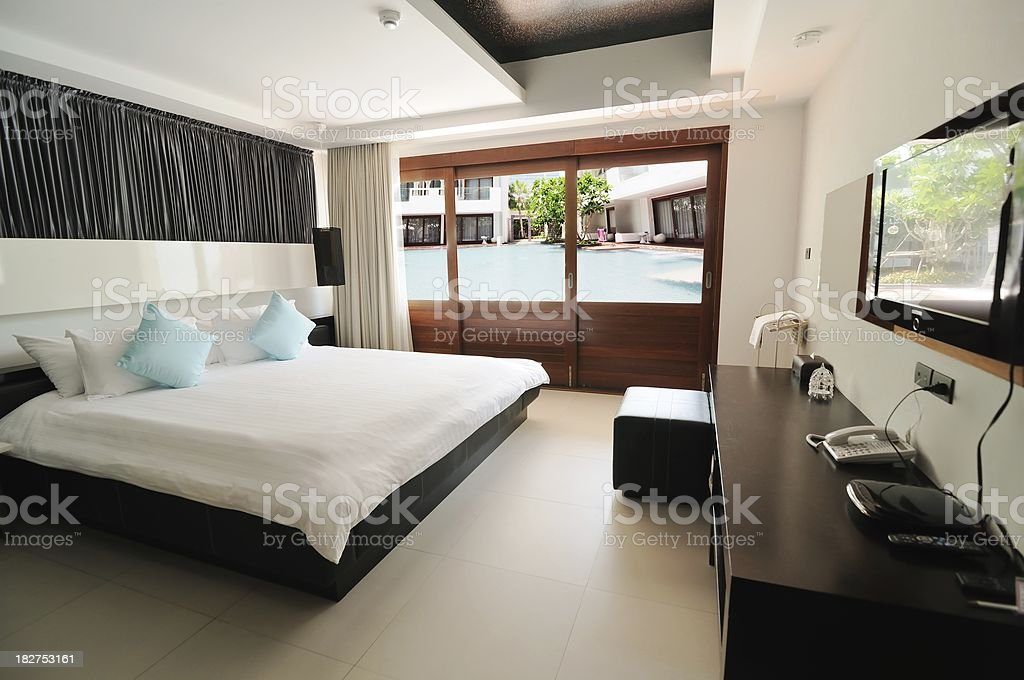 Luxury Hotel bedroom suite poolside view royalty-free stock photo