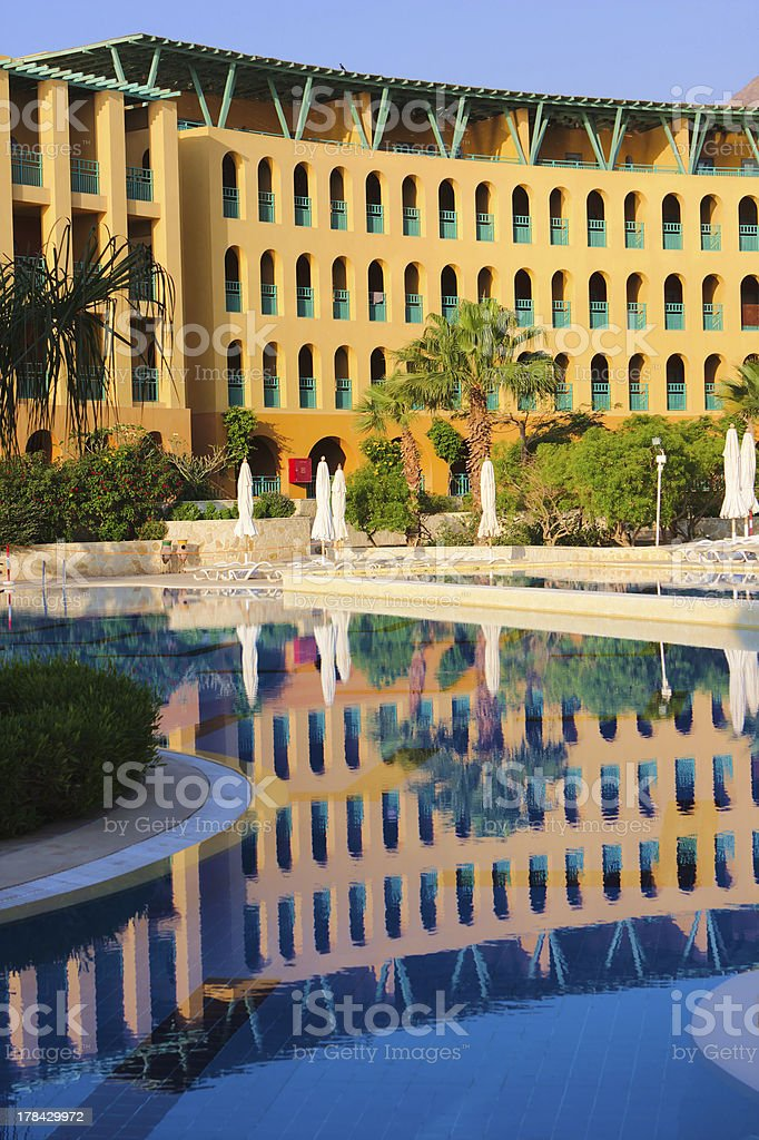 Luxury hotel facade with it's reflection in swimming pool royalty-free stock photo