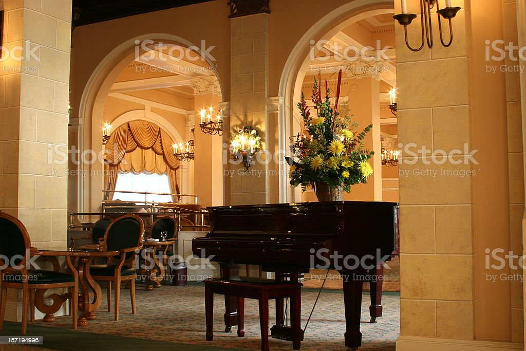 Luxury hotel lobby with piano. Grand foyer entrance. Seating. royalty-free stock photo