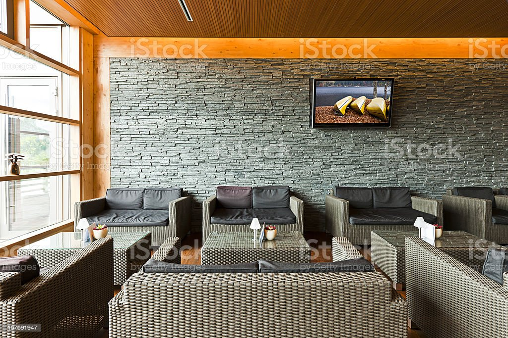 Luxury hotel lobby with tables, sofas and LCD TV stock photo