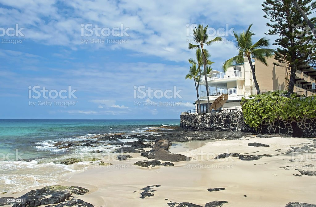Luxury hotel on untouched sandy beach with palms trees royalty-free stock photo