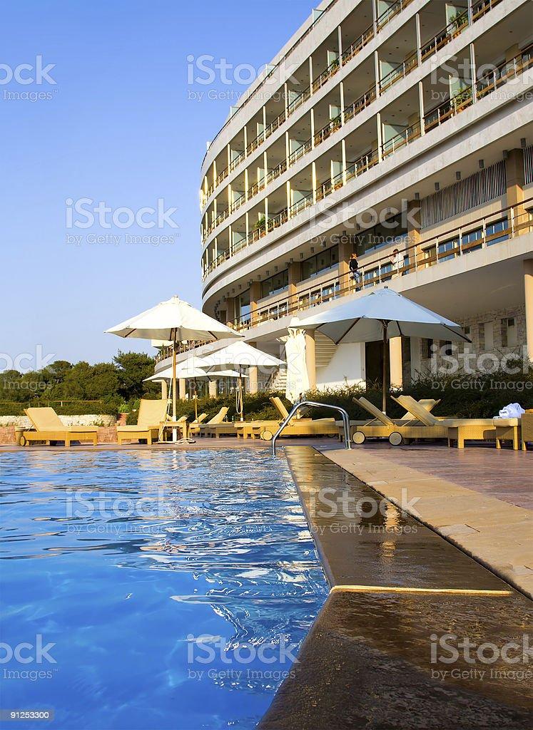 Luxury hotel poolside royalty-free stock photo