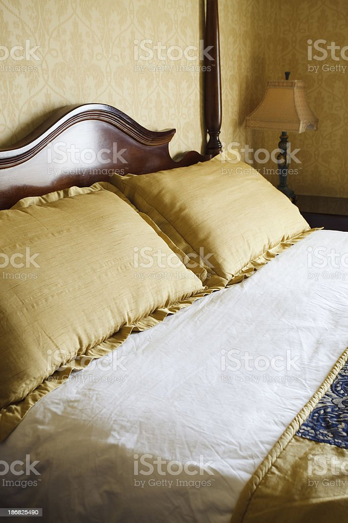 Luxury Hotel Room Bed, Pillows, and Lamp royalty-free stock photo