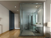 luxury hotel room in a contemporary design with glass bathroom