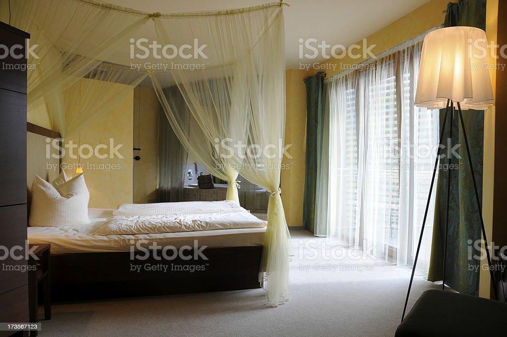 luxury hotel room with canopy bed stock photo