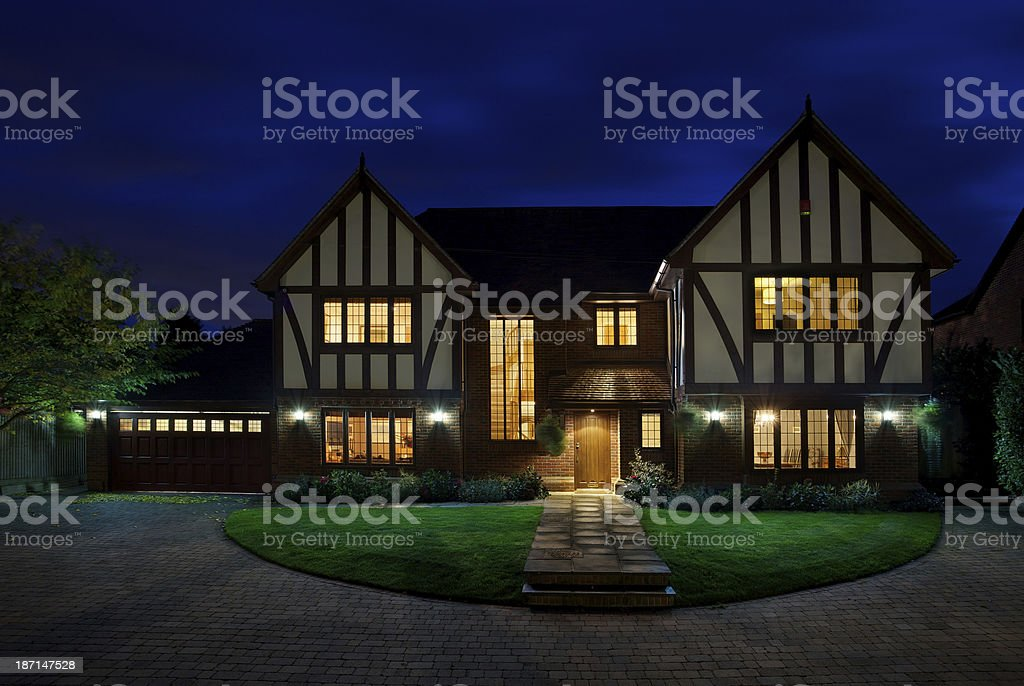 luxury house at dusk stock photo