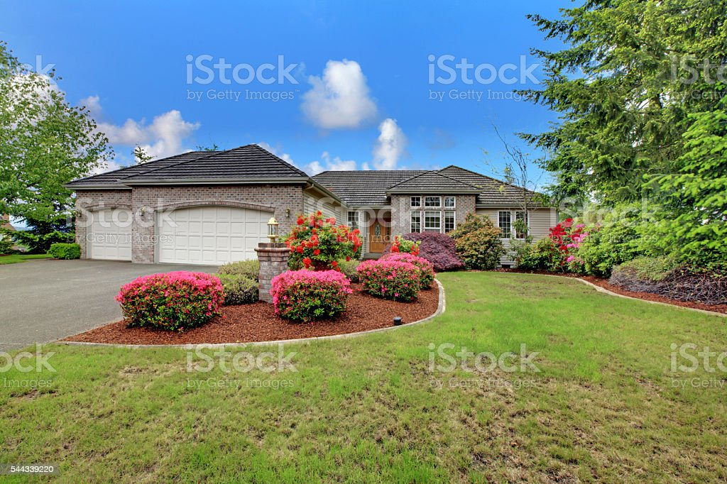 Luxury house exterior with brick trim stock photo