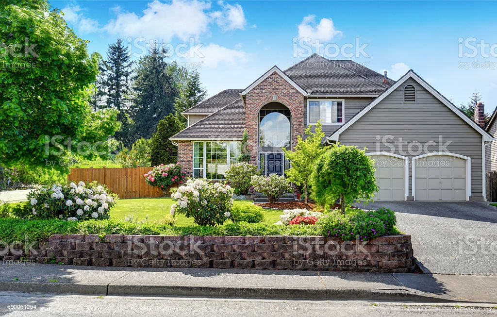 Luxury house exterior with double garage. stock photo