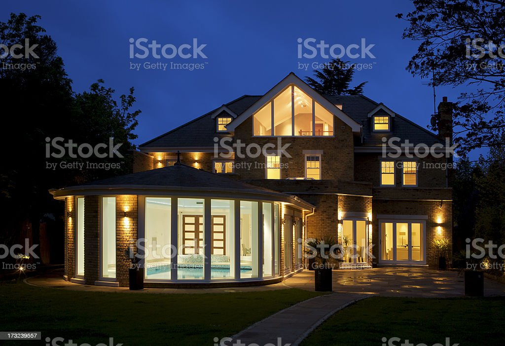 luxury house with pool at dusk stock photo