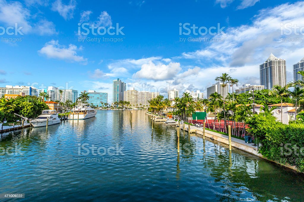 luxury houses at the canal in Miami Beach with boats stock photo