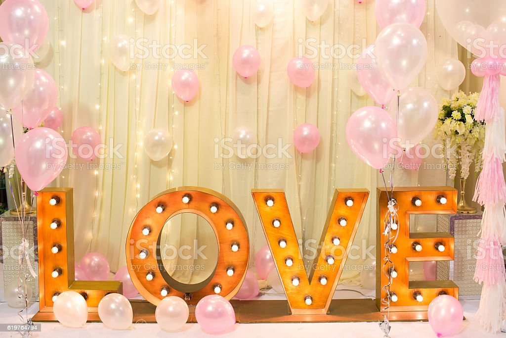 Luxury Indoors Wedding backdrop Decorate with word love light stand stock photo